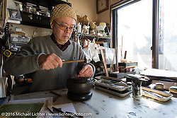 At the home of Cycle West's Hiromichi Nishiyama's father where he works as a sculptor. He aslo has helped Hiro with engraving on some of his custom bikes. Photographed after the Mooneyes Yokohama Hot Rod & Custom Show. Japan. December 8, 2016.  Photography ©2016 Michael Lichter.