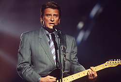 File photo : File photo of French singer and actor Johnny Hallyday (born Jean-Philippe Smet; 15 June 1943), pictured in January 1990. France's biggest rock star Johnny Hallyday has died from lung cancer, his wife says. He was 74. The singer - real name Jean-Philippe Smet - sold about 100 million records and starred in a number of films. Photo by Jean-Claude Roca-MF/ABACAPRESS.COM