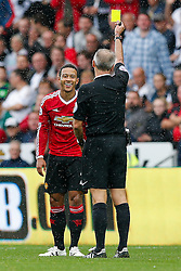 Memphis Depay of Manchester United laughs off a yellow card from referee Martin Atkinson - Mandatory byline: Rogan Thomson/JMP - 07966 386802 - 30/08/2015 - FOOTBALL - Liberty Stadium - Swansea, Wales - Swansea City v Manchester United - Barclays Premier League.