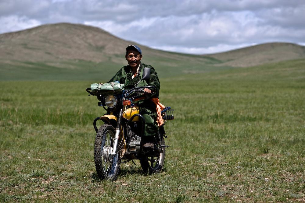 A Mongolian Farmer on his motorbike