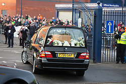 © Licensed to London News Pictures. 30/01/2018. The funeral of footballer Cyrille Regis took place in West Bromwich today. The hearse made it's way past the football ground where he played as family, friends and fans said their final farewell. Pictured, the hearse arrives. Photo credit: Dave Warren/LNP