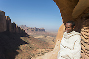 View with priest near entrance Abune Yemata church in the mountains near Hawzen Town, Gheralta area, Tigray, Ethiopia, Horn of Africa