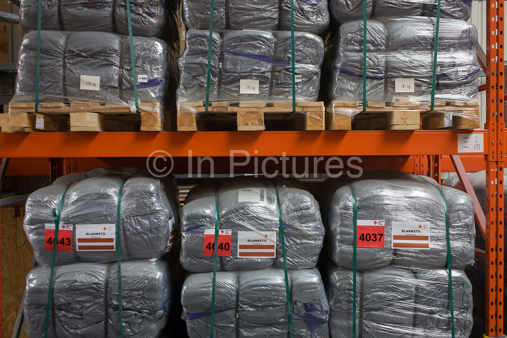 Blankets in emergency supplies warehouse, Deutsches Rotes Kreuz (DRK - German Red Cross) at their logistics centre at Berlin-Schönefeld airport. Ready for immediate loading into disaster zones, the equipment is stored near to where freight aircraft can fly anywhere in the world. The International Red Cross and Red Crescent Movement, with its 187 National Societies, is the world's largest humanitarian network. The German Red Cross is part of this universal community, which started 150 years ago to deliver comprehensive aid to people affected by conflict, disaster, sanitary emergencies, or social hardship, guided solely by their needs. Around four million volunteers and members support the Red Cross in Germany alone.