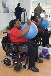 Woman exercising with Swiss ball at the gym,
