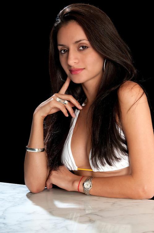 Portrait of young hispanic woman posing very sexy.