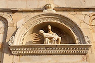 Sculpture of Holy Mary Holding the dead body of Christ by Petar Trogiranin [ 1514 ] above the door of the previous  Cathedral of St Mary the Great (Crkva svete Marije Velike). Rab Island, Craotia .<br /> <br /> Visit our MEDIEVAL PHOTO COLLECTIONS for more   photos  to download or buy as prints https://funkystock.photoshelter.com/gallery-collection/Medieval-Middle-Ages-Historic-Places-Arcaeological-Sites-Pictures-Images-of/C0000B5ZA54_WD0s