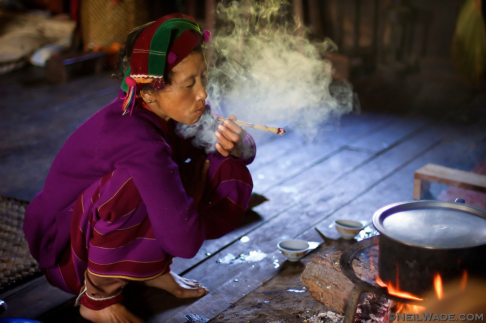 This minority woman is smoking a cheroot, a mild cigar that's popular in Myanmar.  Near Hsipaw, Myanmar (Burma)