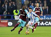 Pedro Obiang of West Ham United shields the ball from Huddersfield Town's Joe Lolley during the Premier League match between Huddersfield Town and West Ham United at the John Smiths Stadium, Huddersfield, England on 13 January 2018. Photo by Paul Thompson.