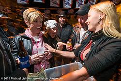 Kristi Verhoff serves up shots at the Boot Hill Saloon on Main Street during Daytona Bike Week. FL, USA. March 13, 2014.  Photography ©2014 Michael Lichter.