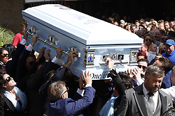 © Licensed to London News Pictures. 21/08/2018. Ashtead, UK. Familly members , including Paddy Doherty, mourn as the coffin of his nephew Mikey Connors is carried from St Michaels Church in Ashstead. 32 year-old Mikey Connors, the nephew of My Big Fat Gypsy Wedding star Paddy Doherty, was killed when his horse-and-cart was hit by a car in Thamesmead on July 28. Photo credit: Peter Macdiarmid/LNP