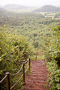 Stairs down the hillside of the Puy de Dôme, the larger extinct volcano in the region of Puy-de-Dôme, near Clermont-Ferrand, France