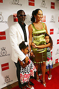 Djimon Hounsou and Kimora Lee Simmons at the Kimora Lee Simmons celebration of the launch of her new fashion collections Fabulosity at JC Penny with party at Hiro on July 16, 2008..Fabulosity is a complete sportswear collection catering to authentic teen girls who want to show the world how fabulous they really are. The line hits JCPenney stores this week featuring tees, knit tops and sweaters, jeans, skirts, dresses, hoodies, jackets and outerwear. The collection embodies a lifestyle of confidence, beauty and fashion sense - at an even more fabulous price point ($29 to $108)..