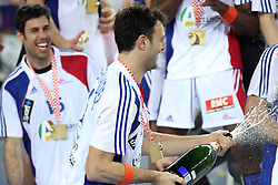 Jerome Fernandez (2) of France celebrates with a champaign after the 21st Men's World Handball Championship 2009 Gold medal match between National teams of France and Croatia, on February 1, 2009, in Arena Zagreb, Zagreb, Croatia. France won 24:19 and became World Champion 2009.  (Photo by Vid Ponikvar / Sportida)
