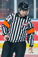 KELOWNA, BC - JANUARY 31: Referee Chris Crich stands on the ice with the puck at the start of the game between the visiting Spokane Chiefs and the Kelowna Rockets at Prospera Place on January 31, 2020 in Kelowna, Canada. (Photo by Marissa Baecker/Shoot the Breeze)