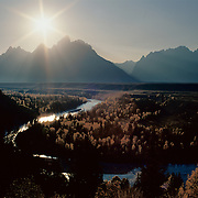 Grand Teton range rises sharply into the Wyoming sky above the Snake River in Grand Teton National Park, WY.