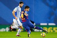 Real Sociedad's Raul Navas (l) and FC Barcelona's Luis Suarez during La Liga match. January 14,2018. (ALTERPHOTOS/Acero)