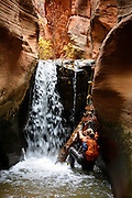 A hiker exploring a canyon, Zion National Park, Utah.  (model released)