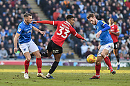 Portsmouth Midfielder, Tom Naylor (7) gets the ball from Barnsley Forward, Victor Adeboyejo (29) during the EFL Sky Bet League 1 match between Portsmouth and Barnsley at Fratton Park, Portsmouth, England on 23 February 2019.