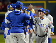 CLEVELAND, OH - OCTOBER 25: Manager Joe Maddon of the Chicago Cubs greets his players on the field before the start of Game 1 of the 2016 World Series against the Cleveland Indians at Progressive Field on Tuesday, October 25, 2016 in Cleveland, Ohio. (Photo by Ron Vesely/MLB Photos via Getty Images)