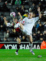 Photo: Leigh Quinnell/Sportsbeat Images.<br /> Milton Keynes Dons v Chesterfield. Coca Cola League 2. 24/11/2007. Chesterfields Jamie Ward kicks up with MK Dons Danny Swailes.