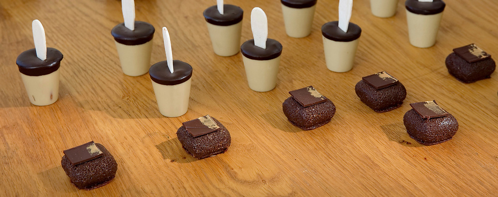 Chocolate flavoured mousse on a stick on a buffet table