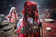 Chinor wears the traditional 6-braids of an unmarried girl - she will have 2 long braids when married. For practical reasons the braids are buttoned to the back of her dress, keeping the long hair out of the way as she does her various chores around camp...Daily life at the Khan (chief) summer camp of Kara Jylga...Trekking through the high altitude plateau of the Little Pamir mountains (average 4200 meters) , where the Afghan Kyrgyz community live all year, on the borders of China, Tajikistan and Pakistan.