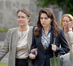 01 June  2015. New Orleans, Louisiana. <br /> Rita Benson LeBlanc (center) and her mother Renee (left) leave a court hearing to determine the competency of grandfather/father Tom Benson. Benson is the billionaire owner of the NFL New Orleans Saints, the NBA New Orleans Pelicans, various Mercedes dealerships, banks, property assets and a slew of business interests. Rita, her brother and mother demanded a competency hearing after Benson changed his succession plans and decided to leave the bulk of his estate to third wife Gayle, sparking a controversial fight over control of the Benson business empire.<br /> Photo©; Charlie Varley/varleypix.com