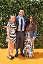 Left to right, PRINCESS GABRIELLA KHAN, HH PRINCE RASHID ALI KHAN and PRINCESS ISABEL KHAN at the Veuve Clicquot Gold Cup Final at Cowdray Park Polo Club, Midhurst, West Sussex on 20th July 2014.