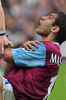 Javier Mascherano (West Ham) holds his shoulder, after being bitten by Jermaine Defoe (Spurs). BARCLAYS PREMIERSHIP. TOTTENHAM HOTSPUR v WEST HAM UNITED. 22/10/2006. CREDIT COLORSPORT / KIERAN GALVIN