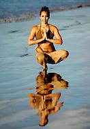 Hatha yoga on the beach