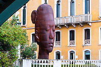 Italy, Venice. A huge sculpure of a head along Canal Grande.