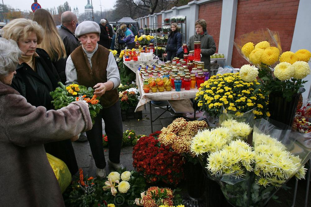 Preparing for All Saints Day. Powazek Cemetery. Warsaw, Poland. Flower, wreath sellers.