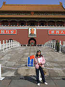 Young Chinese tourist haven her picture taken in front of the Forbidden City