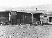 0011-01B. Indian house in Celilo Indian Village before demolition by the Army  Corps of Engineers  in 1957.