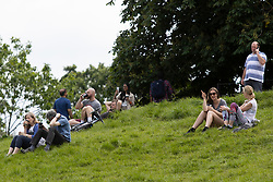 © Licensed to London News Pictures. 07/06/2021. London, UK. Members of the public relax during sunny weather in Greenwich Park in South East London. Temperatures are expected to rise with highs of 24 degrees forecasted for parts of London and South East England today . Photo credit: George Cracknell Wright/LNP