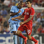 Fernando, (left), Manchester City, and Philippe Coutinho, Liverpool, contest a header during the Manchester City Vs Liverpool FC Guinness International Champions Cup match at Yankee Stadium, The Bronx, New York, USA. 30th July 2014. Photo Tim Clayton