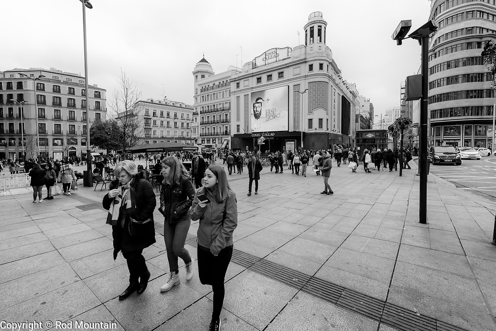 Madrid, Spain - February 15, 2018 - Located in the centre of Spain's capital, the Plaza del Callao was formally opened in 1866 and remembers the Battle of Callao between the Spanish naval forces and the Peruvian army.<br /> <br /> Image: © Rod Mountain <br /> <br /> http://www.rodmountain.com <br /> http://bit.ly/Madrid_bw<br /> Nikon D800 / Nikkor Lens <br /> <br /> @spain @visita_madrid @NikonUSA @nikoncanada @nikoneurope<br /> <br /> @spain.info @visitamadridoficial @NikonUSA @nikoncanada @nikoneurope<br /> <br /> @spain @Visita_Madrid @NikonUSA @nikoncanada @nikoneurope @TurismoMadrid<br /> <br /> https://www.spain.info/en/<br /> https://en.wikipedia.org/wiki/Callao_Square<br /> <br /> #streetscene #streetmobs#peopleinsquare #bnwhole #bnw_greatshots #love_bnw  #wonderearthclubbw #wu_europe #streetdreamsmag#neverstopexploring #shotwithlove #shotzdelight #citylifemadrid #citylife #citylifemadrid #wonderlust.spain #spain🇪🇸 #instago #travelingram #everydaymadrid #igfotogram_bw #excellent_bnw