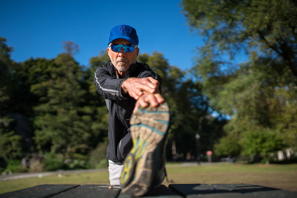 MANHATTAN, NY - OCTOBER 4, 2015: John Luther Adams at Morningside Park stretches with the help of a park bench and table before his daily run. CREDIT: Emon Hassan for The New York Times