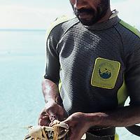 Fiji Islands, Yanuca Island, island fisherman with fresh caught crab