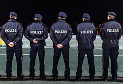 THEMENBILD - Rückenansicht von männlichen Polizisten die in einer Reihe stehen, aufgenommen am 23. Feber 2017 in Innsbruck, Österreich // Back view of male police officers standing in a row, Innsbruck, Austria on 2017/02/23. EXPA Pictures © 2017, PhotoCredit: EXPA/ JFK