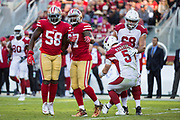 San Francisco 49ers defensive end Elvis Dumervil (58) celebrates with San Francisco 49ers linebacker Dekoda Watson (97) after sacking Arizona Cardinals quarterback Drew Stanton (5) at Levi's Stadium in Santa Clara, Calif., on November 5, 2017. (Stan Olszewski/Special to S.F. Examiner)