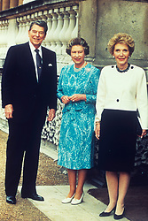 Queen Elizabeth with former American President Ronald Reagan and his wife Nancy. Reagan was accepting an Honorary Knighthood at Buckingham Palace.