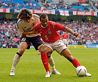 Fotball<br /> Photo. Jed Wee, Digitalsport<br /> NORWAY ONLY<br /> <br /> England v Japan, The FA Summer Tournament, 01/06/2004.<br /> England's Ashley Cole (R) holds off Japan's Shumsuke Nakamura.