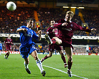 Photograph: Scott Heavey.<br />Chelsea v Sparta Prague. Group G Champions League. 26/11/2003.<br />Joe Cole can do nothing as Pavel Pergl clears his lines