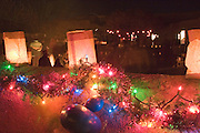 Holiday lights and lanterns on adobe wall in New Mexico<br />