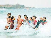 People in the ocean at Kovalam Beach, near Trivandrum (Thiruvananthapuram), Kerala, India