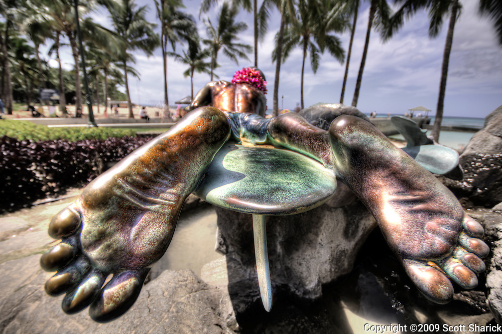 A view from the foot end of the Surfer and Seal statue in Waikiki.