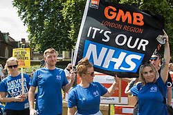 NHS workers from the grassroots NHSPay15 campaign prepare to march from opposite Parliament to 10 Downing Street with a petition started by NHS Wales nurse Matthew Tovey (c) and signed by over 800,000 people calling for a 15% pay rise for NHS workers on 20th July 2021 in London, United Kingdom. At the time of presentation of the petition, the government was believed to be preparing to offer NHS workers a 3% pay rise in 'recognition of the unique impact of the pandemic on the NHS'.