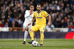 (l-r) Raphael Varane of Real Madrid, Gonzalo Higuain of Juventus FC during the UEFA Champions League quarter final match between Real Madrid and Juventus FC at the Santiago Bernabeu stadium on April 11, 2018 in Madrid, Spain