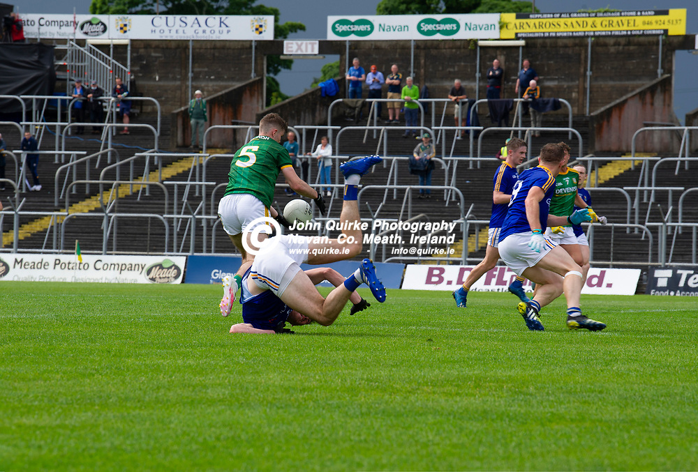 04-07-21. Meath v Longford - Leinster SFC Quarter-Final at Pairc Tailteann, Navan.<br />Cathal Hickey (5) finds the net with this shot for a Meath goal as Enda Macken, Longford tales a heavy fall.<br />Photo: John Quirke / www.quirke.ie<br />©John Quirke Photography, 16 Proudstown Road, Navan. Co. Meath. (info@quirke.ie / 046-9028461 / 087-2579454).